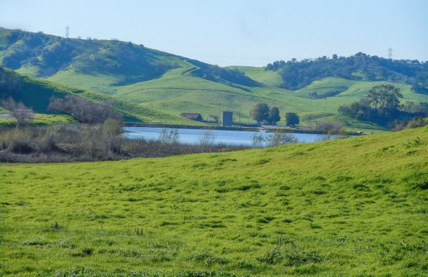 Views of Tres Hermanos, a 2,450-acre ranch with rolling hills and a reservoir. (Photo courtesy Teresa Wang file)