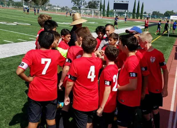 The Strikers FC North gather for a quick pre-game word in memory of Felipe De La Cruz who collapsed on the field and died while playing soccer on Saturday, Aug. 26, at Westminster High School. (Photo courtesy of Ron Esparza)