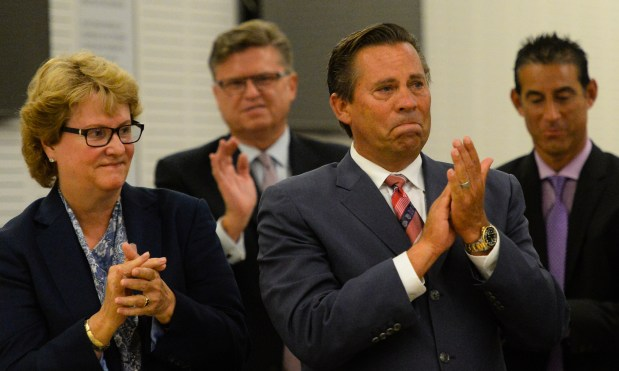 From left, attorney Jennifer Keller, former Assistant Assessor Jim Erwin and developer Jeff Burum applaud the jury for their service after Burum, Supervisor Paul Biane and Mark Kirk were found not guilty of all charges in the Colonies corruption case verdict hearing at San Bernardino Superior Court in San Bernardino, Calif. on Monday, Aug. 28, 2017. Defendants Burum, Biane and Kirk were found not guilty after a marathon trial that has lasted nearly eight months. (Photo by Rachel Luna, The Sun/SCNG)