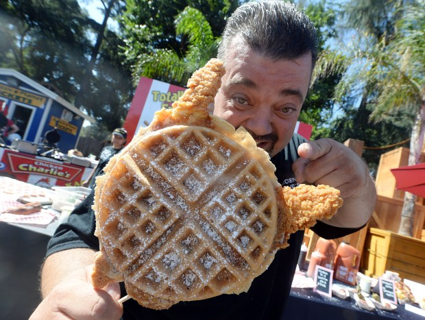Chicken Charlie holds a serving of chicken and waffles at Fairplex in Pomona Wednesday August 31, 2016. The LA County Fair opens Friday and runs through September 24. (File photo by Will Lester/SCNG-INLAND VALLEY DAILY BULLETIN)