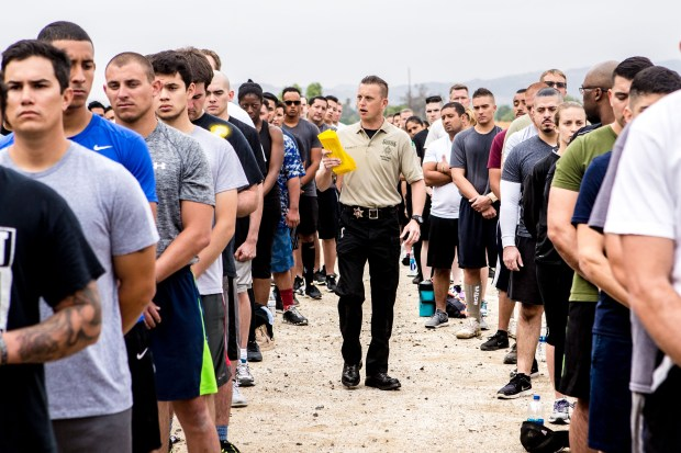 Correctional Deputy Randall Tackett, center, gives out instructions to applicants as they take part in the agility test to potentially become new Riverside County Sheriff's deputies at Ben Clark Public Safety Training Center in Riverside in August.Photo by Watchara Phomicinda, The Press-Enterprise/SCNG