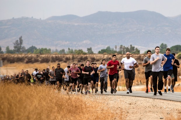 Applicants run a 1.5-mile course during the agility test to potentially become new Riverside County Sheriff's deputies at Ben Clark Public Safety Training Center in Riverside in August.Photo by Watchara Phomicinda, The Press-Enterprise/SCNG