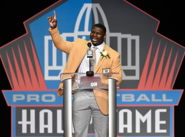 Former NFL running back LaDainian Tomlinson delivers his speech during an induction ceremony at the Pro Football Hall of Fame Saturday, Aug. 5, 2017, in Canton, Ohio. (AP Photo/David Richard)