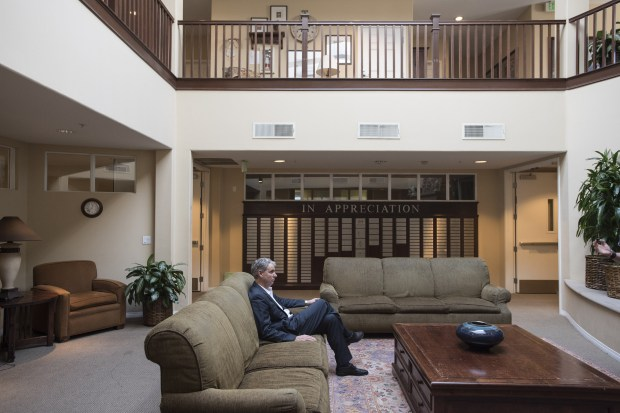 Mercy House Executive Director Larry Haynes sits in the lobby of Emmanuel House in Santa Ana, an apartment house for homeless people with HIV/AIDs and one of several housing programs for the homeless that the nomprofit runs in Orange County. (Photo by Kyusung Gong,SCNG)