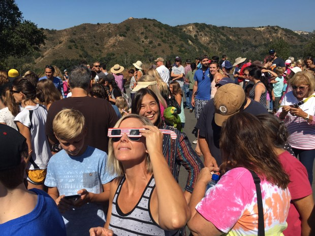 Spectators watch a partial solar eclipse as seen from Caspers Wilderness Park in San Juan Capistrano on Monday, August 21, 2017. (Photo by Mark Rightmire,Orange County Register/SCNG)