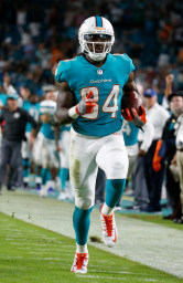 Miami Dolphins wide receiver Damore'ea Stringfellow (84) runs for a touchdown, during the second half of an NFL preseason football game against the Atlanta Falcons, Thursday, Aug. 10, 2017, in Miami Gardens, Fla. (AP Photo/Wilfredo Lee)