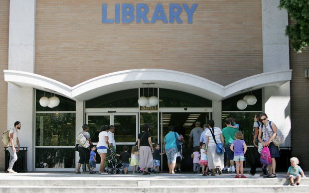 Visitors enter Riverside's Main Library in 2015. /File photo by Terry Pierson, The Press-Enterprise/SCNG
