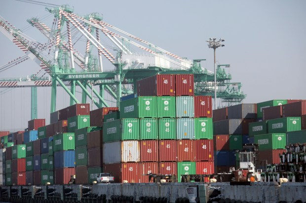 FILE - In this Sept. 23, 2009 file photo, containers offloaded from a ship sit dockside in the Port of Los Angeles, in the San Pedro section of Los Angeles.