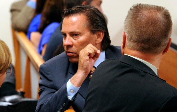 Colonies corruption defendant Jeff Burum speaks with a supporter during an arraignment hearing in a San Bernardino Superior Courtroom August 19, 2011. GABRIEL LUIS ACOSTA/STAFF PHOTOGRAPHER.