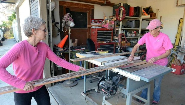 Sisters Helen and Carol Garner work in the garage of the historic home they restored in Anaheim. (Register file photo)