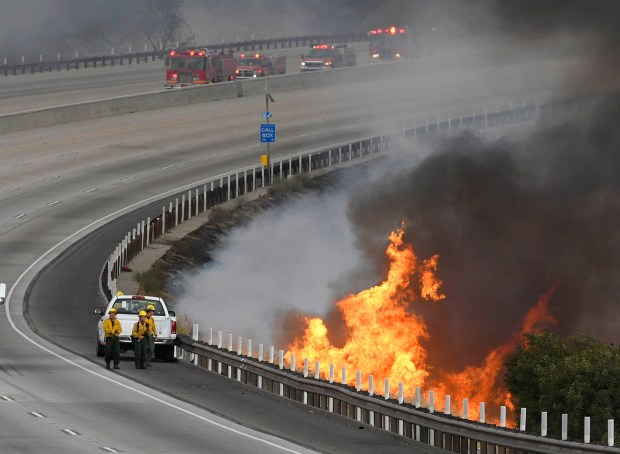 Firefighters park near flame on the 210 freeway near Sunland Blvd. The fire burned from here, all the way to the La Tuna Canyon off ramp of the 210 freeway. Tujunga, CA 9/1/2017 (Photo by John McCoy, Los Angeles Daily News/SCNG)