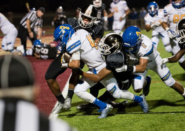 Bishop Amat's Christopher Lopez crashes through JSerra defenders for a touchdown during a game between the two teams on Friday night, September 8, 2017.Photo By Jeff Antenore, Contributing Photographer
