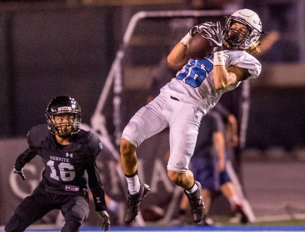 Villa Park''s Dylan Bonilla, right, jumps up to catch a pass in front of Servite's Samuel Rovano in the fourth quarter in Cerritos on Friday, September 15, 2017. (Photo by Paul Rodriguez, Orange County Register/SCNG)
