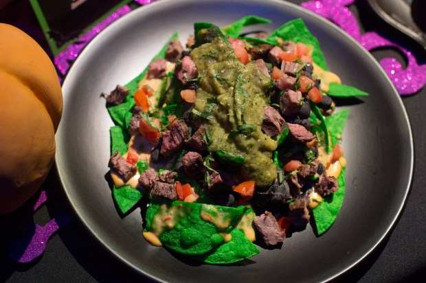 The Ghost-ly Pepper Nachos feature ghost pepper marinated flank steak, green tortilla chips, ghost pepper cheese, black beans and avocado-tomatillo salsa available at the Cove Bar inside Disney California Adventure on Friday, September 15, 2017. (Photo by Drew A. Kelley, Contributing Photographer)