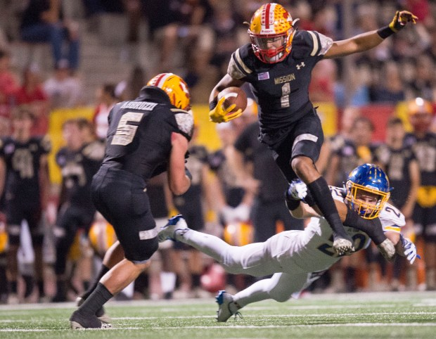 Mission Viejo's Elijah Collier leaps over El Toro's Sam Whipple during a game at Mission Viejo High School in Mission Viejo on Friday, September 29, 2017. (Photo by Matt Masin, Orange County Register, SCNG)