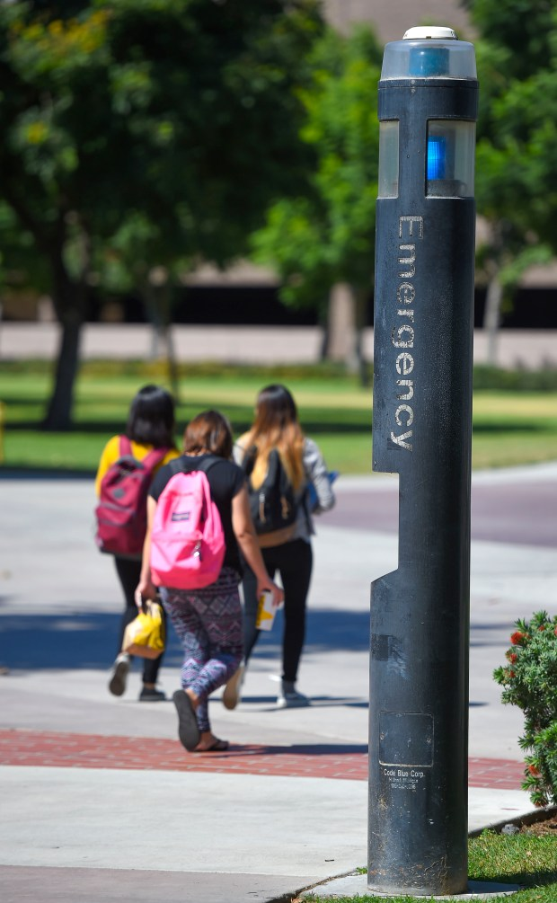 Students walk past an emergency call box on the CSULB lower campus in Long Beach on Friday, September 22, 2017. (Photo by Scott Varley, Press-Telegram/SCNG)