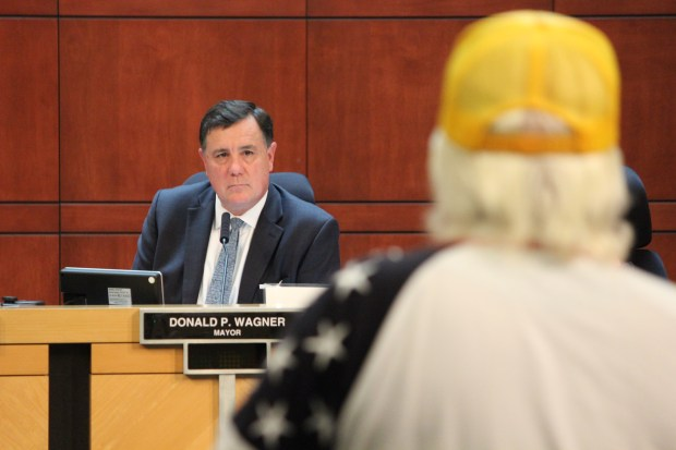 Irvine Mayor Don Wagner listens to Vietnam war veteran Bill Cook address the City Council about the state's plan to build a military veterans cemetery at the former El Toro Marine base Sept. 26, 2017. (Tomoya Shimura, Orange County Register/SCNG)