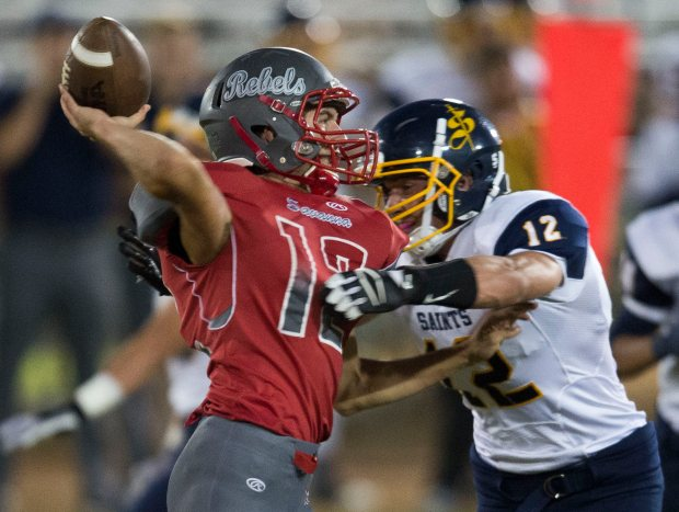 Savanna quarterback Ryley Smith, left, pictured here in 2016, leads a potent Rebels offense averaging 35 points per game through four weeks. (Photo by Kevin Sullivan, Orange County Register/SCNG)