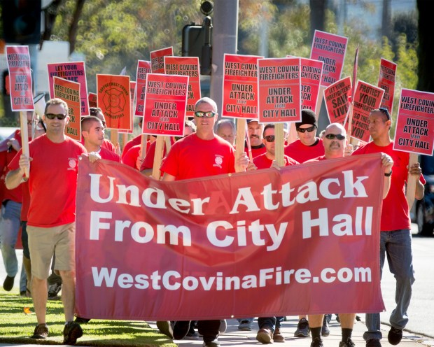 *** STAFF FILE PHOTO *** West Covina firefighters take their contract dispute with City Hall to the street by picketing at the corner of Vincent Avenue and Lakes Drive, then marching to the Civic Center bringing attention to their contract dispute with city officials Nov. 30, 2016. The firefighters' union has been without a contract for more than two years. (Photo by Leo Jarzomb, SGV Tribune/ SCNG)