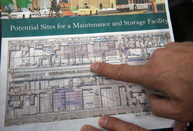 Peter Scholz, owner of Showcase Inc., shows where his business sits on an artist rendering of a potential sites for a maintenance and storage facility along Aetna Street, on Thursday in Van Nuys, Sept. 28, 2017. He is concerned about a massive Metro transit project that could potentially force his 30-year business to relocate elsewhere. (Photo by Ed Crisostomo, Los Angeles Daily News/SCNG)
