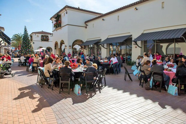 Shoppers enjoy lunch at the first annual Outlets at San Clemente' Shopping Extravaganza charity fundraiser held in 2015. (Courtesy of Outlets at San Clemente)
