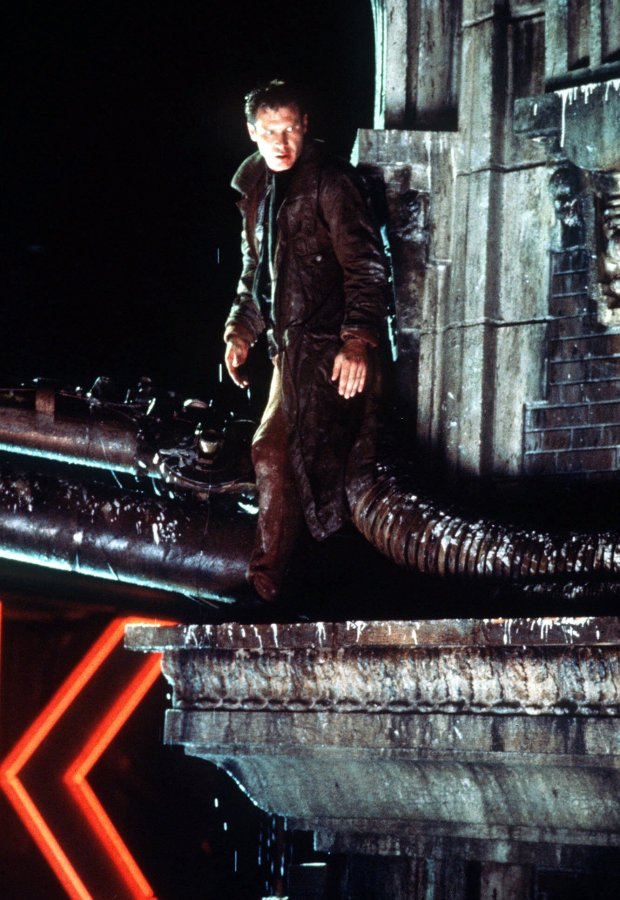 """Harrison Ford as Rick Deckard watches for pursuing a in Ridley Scott's 1982 """"Blade Runner."""""""