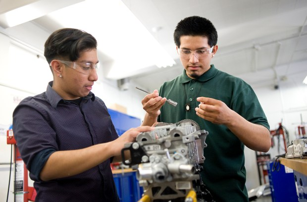 Students at Valley High in Santa Ana learn skills for a career in automotive repair through a High School Inc. program. (Photo by Nick Agro, Orange County Register/SCNG)