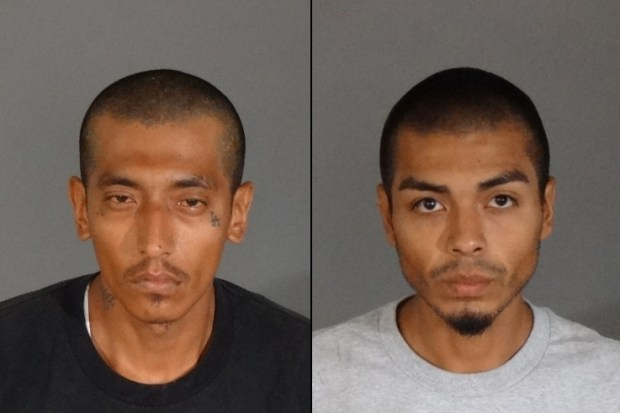 "George Rosales, 26, left, and Jesus Guzman, 22, were arrested on suspicion of shooting a homeless man with a converted paintball gun in an effort to force the victim to pay them a $25 ""tax"" to live in a public park in North Hollywood. (Booking mugs courtesy of the LAPD)"