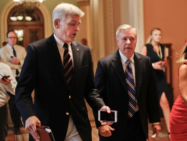 In this July 13, 2017, file photo, Sen. Bill Cassidy, R-La., left, and Sen. Lindsey Graham, R-S.C., right, talk while walking to a meeting on Capitol Hill in Washington. Senate Republicans are planning a final, uphill push to erase President Barack Obama's health care law. But Democrats and their allies are going all-out to stop the drive. The initial Republican effort crashed in July in the GOP-run Senate. Majority Leader Mitch McConnell said after that defeat that he'd not revisit the issue without the votes to succeed. Graham and Cassidy are leading the new GOP charge and they'd transform much of Obama's law into block grants and let states decide how to spend the money. (AP Photo/Pablo Martinez Monsivais, File)