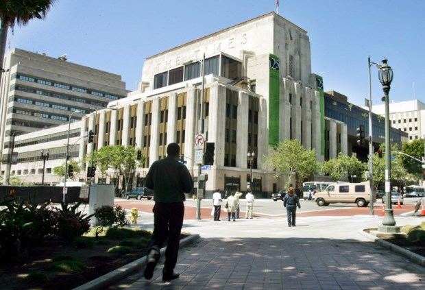 The editorial employees of The Los Angeles Times are voting on whether or not to unionize. The company is against the move. Shown above is the newspaper's historic LA headquarters. (AP File Photo/Reed Saxon)