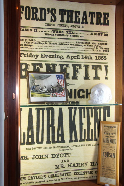 A display focusing on Lincoln's assassination includes a Ford Theatre playbill, an 1865 plaster life mask of the president and a few strands of hair cut from his head after he was shot.