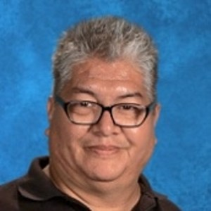 Frank Garcia teaches band, orchestar and is the performing arts department chairperson at Los Amigos High School. (Photo courtesy of Los Amigos High School)
