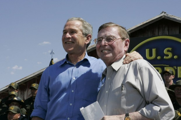 In this June 6, 2006, file photo, President George W. Bush stands with Sen. Pete Domenici, R-N.M., before speaking about border security and immigration reform at the Federal Law Enforcement Training Center in Artesia, N.M. (AP Photo/Charles Dharapak, File)