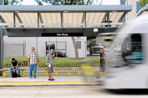 Orange Line riders wait at the Van Nuys station as a bus approaches, Tuesday, May 20, 2014. The Metro board will vote on a fare hike on Thursday to help cut deficits. (Photo by Michael Owen Baker/Los Angeles Daily News)
