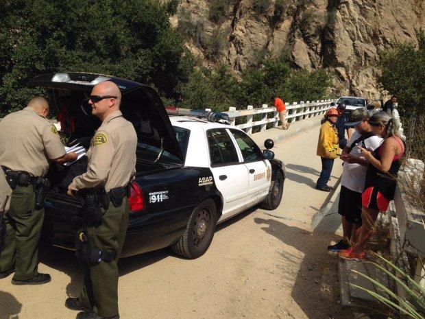 Deputies arrested a woman on suspicion of setting a fire along an Altadena hillside on Friday, Sept. 22, 2017.