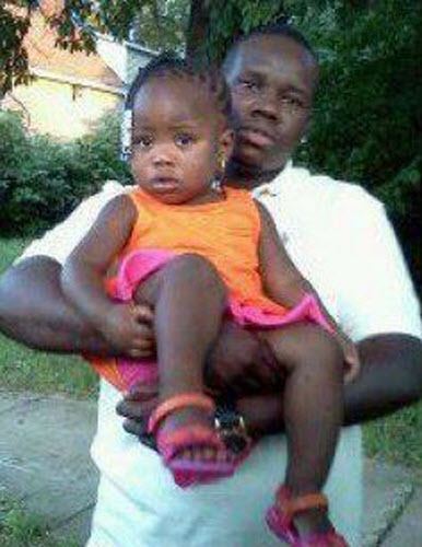 This undated family photo supplied by Christina Wilson shows Anthony Lamar Smith holding his daughter Autumn Smith. Anthony Lamar Smith was killed in 2011 during a confrontation with police. Former St. Louis police officer Jason Stockley, who was charged with first-degree murder and armed criminal action in the December 2011 shooting death of Smith, was acquitted in the killing. (Family photo courtesy Christina Wilson via AP)