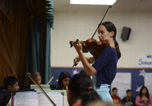 Sarah Grenier teaches instrumental and vocal music at Ensign Intermediate School. (Photo by Mike Greene, Orange County Register)