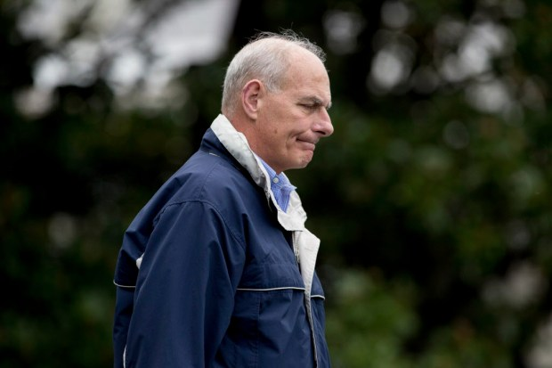 President Donald Trump's Chief of Staff John Kelly walks across the South Lawn to Marine One at the White House in Washington, Thursday, Sept. 14, 2017, to travel with President Donald Trump for a short trip to Andrews Air Force Base and then on to Fort Myers, Fla. to meet with citizens impacted by Hurricane Irma. (AP Photo/Andrew Harnik)