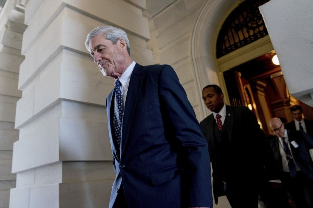 In this June 21, 2017, photo, former FBI Director Robert Mueller, the special counsel probing Russian interference in the 2016 election, departs Capitol Hill following a closed door meeting in Washington. (AP Photo/Andrew Harnik, File)