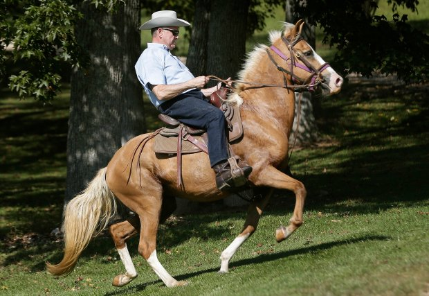 Former Alabama Chief Justice and U.S. Senate candidate Roy Moore rides in on a horse to vote at the Gallant Volunteer Fire Department during the Alabama Senate race, Tuesday, Sept. 26, 2017, in Gallant, Ala. (AP Photo/Brynn Anderson)