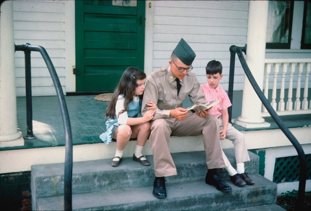 American soldier with his siblings before leaving for Vietnam. 1965.