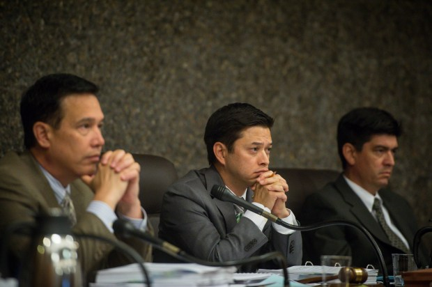 Alhambra's City Manager Mark Yokoyama, left, Vice Mayor Jeff Maloney and Attorney Joseph Montes listen on Monday night, Sept. 25, 2017, to public speakers arguments against the removal of mature trees for the Camellia Court project at the Scripps Kensington Retirement Community Center site in Alhambra. (Photo by Sarah Reingewirtz, Pasadena Star-News/SCNG)