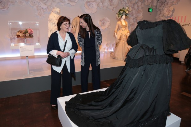 Victoria & Abdul Costume Designer, Consolata Boyle, and FIDM Museum Associate Curator, Christina Johnson, examine a gown worn by Queen Victoria, c. 1897, from the FIDM Museum Permanent Collection. (Courtesy photo by Alex Berliner)