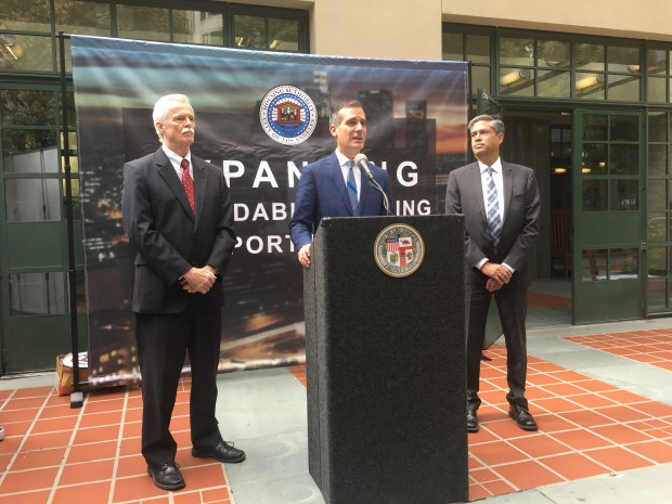 Photo by Elizabeth Chou, Los Angeles Daily News/SCNGDuring an Oct. 2, 2017 press conference, L.A. Mayor Eric Garcetti is flanked on the left by Doug Guthrie, the head of the Housing Authority of the City of Los Angeles (HACLA), and on the right by Carlos Van Natter, who leads the division administering HACLA's Section 8 program.