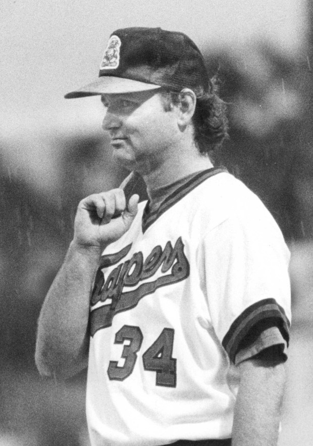 In this July 24, 1985 photo, actor/comedian Bill Murray delivers signals as the first-base coach of the Salt Lake City Trapper. PHOTO COURTESY OF SALT LAKE TRIBUNE LIBRARY