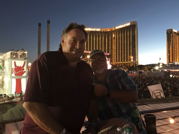 Lyndon Mumm and Julius Linas Brinkis pose for a photo from a VIP area during the Route 91 Harvest Festival in Las Vegas, Sunday night. (Courtesy of Lynette Brinkis)