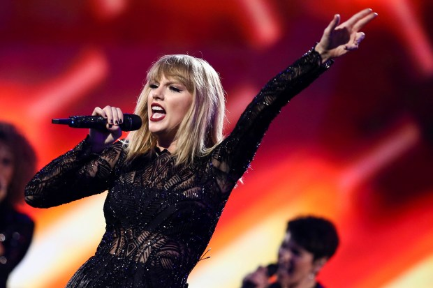 Taylor Swift will headline KIIS 102.7/FM's annual Jingle Ball at the Forum in Inglewood on Friday, Dec. 1. (Photo by John Salangsang, Associated Press)