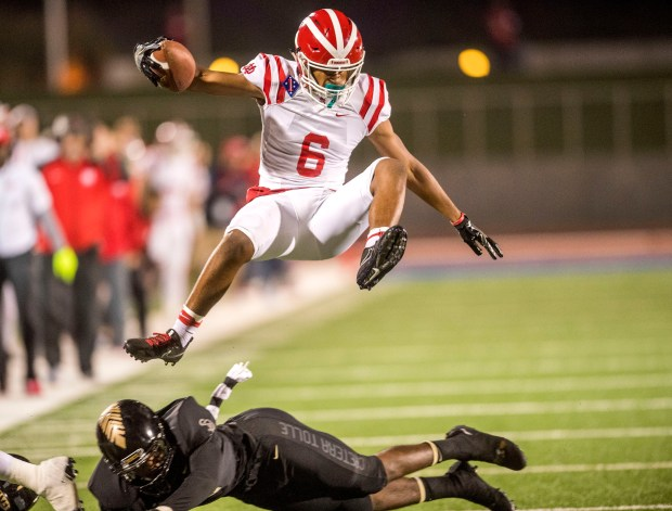 Mater Dei's Christopher Parks hurdles over a St. John Bosco defender close to the end zone in the first quarter in Torrance, CA on Friday, October 13, 2017. (Photo by Paul Rodriguez, Orange County Register/SCNG)