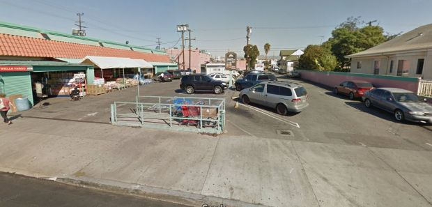 A baby died after she was found naked, unconscious and covered with white powder with an 8-year-old girl and a 26-year-old woman believed to be their mother early Thursday, Oct. 19, 2017, in this parking lot behind the Numero Uno Market at South San Pedro and East 23rd streets in South Los Angeles. (Google Street View)