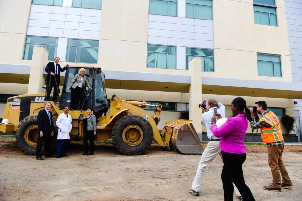 Hospital officials participate in an informal ground breaking photoshoot at the operating room expansion construction site at Redlands Community Hospital in Redlands, Calif. on Friday, Oct. 20, 2017. The expansion is expected to be competed in 12 to 15 months. (Photo by Rachel Luna, Redlands Daily Facts/SCNG)